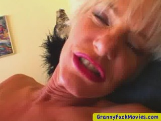 pale cougar masturbating with a little device