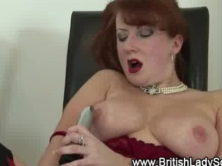grownup redhaired into pantyhose takes off