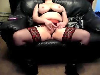 busty housewife on a leather armchair at house