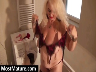 chubby mature pale with large melons takes naked