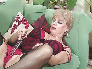 british granny pleases herself on sofa