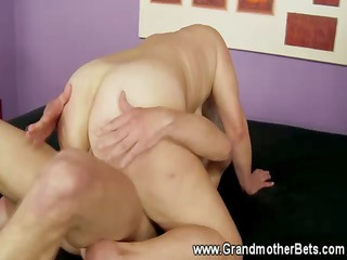 blonde granny rides a uneasy  penis