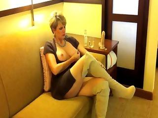 plump mature blond sits single drinking next