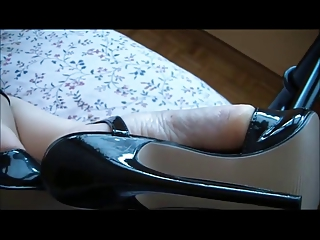 woman feets inside awesome highheels