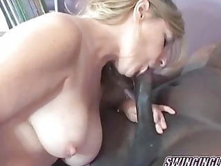 older  blonde swinger liisa is licking some penis