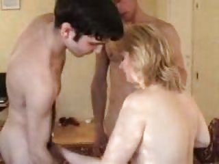 filming his swinger woman with two amateur men