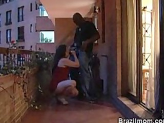 brazilian grown-up lady slowly licking a penis