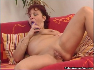 sleazy older woman works her meaty pussy muscle